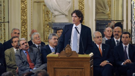 Argentine Economy minister Martin Lousteau speaks about the farmer's strike as other minister listen at the Government house on March 31, 2008 in Buenos Aires. The crippling strike --which has entered its 19th day and was announced to continue until next Wednesday-- has become one of the longest labor stoppages in this country's history. Argentina is the world's leading exporter of oil and oilseed meal and the third in soybeans, and foreign sales of 2.2 million tons of grains, oils and oilseeds flours derived from soybeans and sunflower are virtually paralysed following the strike.         AFP PHOTO/DANIEL GARCIA (Photo credit should read DANIEL GARCIA/AFP/Getty Images)