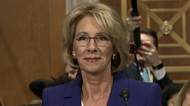 DeVos pledges to resolve conflicts of interest