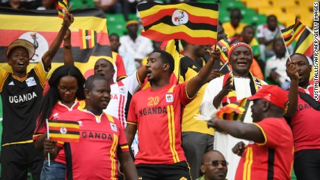 Uganda supporters cheer for their team ahead of the 2017 Africa Cup of Nations group D football match between Ghana and Uganda in Port-Gentil on January 17, 2017. / AFP / Justin TALLIS        (Photo credit should read JUSTIN TALLIS/AFP/Getty Images)