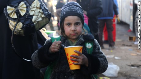A Syrian girl evacuated from rebel-held eastern Aleppo, eats after arriving in opposition-controlled Khan al-Assal.