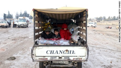 Syrians, who left the last rebel-held pockets of Syria's northen city of Aleppo, arrive on December 22, 2016 in the opposition-controlled Khan al-Assal region, west of the embattled city.