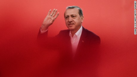 Recep Tayyip Erdogan greets supporters on August 7, 2016 during a rally against July's failed military coup.