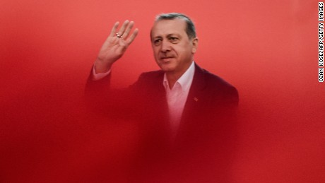 Turkish President Recep Tayyip Erdogan greets supporters on August 7, 2016 in Istanbul during a rally against July's failed military coup.