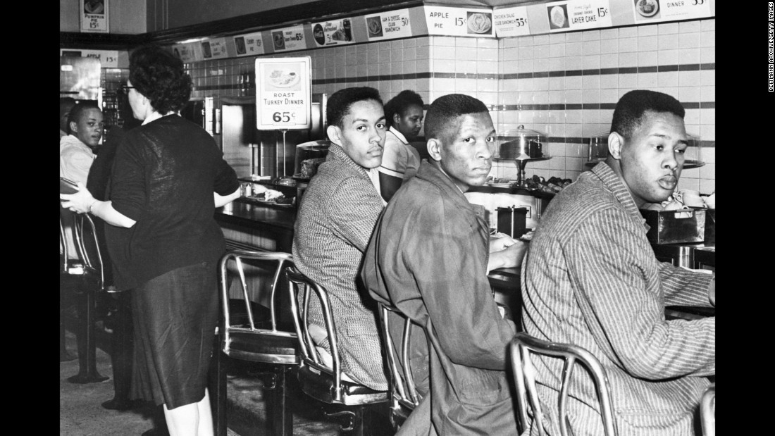 "Ronald Martin, Robert Patterson and Mark Martin sit at a whites-only lunch counter in Greensboro, North Carolina, on February 2, 1960. A day earlier, four African-American college students made history when they sat at the same Woolsworth's counter. Service never came for the ""Greensboro Four,"" as they came to be known, and their peaceful demonstration drew national attention and sparked more sit-ins in Southern cities."