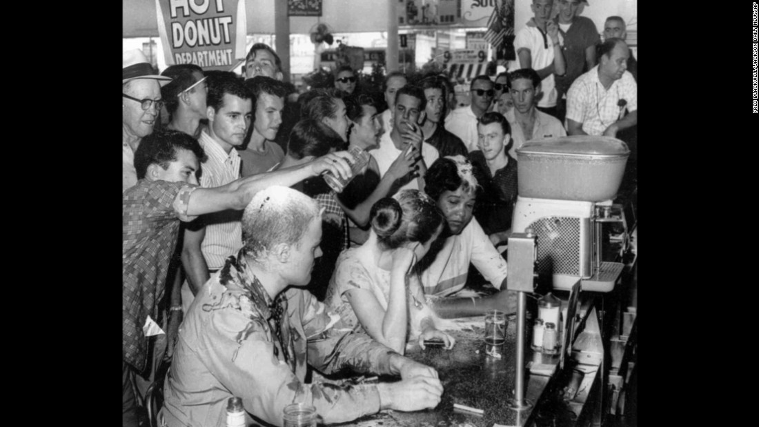 People poured sugar, ketchup and mustard over the heads of Tougaloo College students who were conducting a sit-in at a Woolsworth's in Jackson, Mississippi, in May 1963. Sitting at the counter, from left, are Tougaloo professor John Salter and students Joan Trumpauer and Anne Moody.