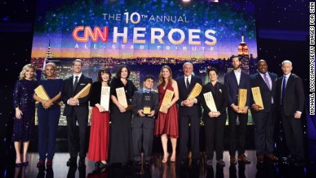 "The 2016 Top 10 CNN Heroes pose with Anderson Cooper and Kelly Ripa on stage after ""CNN Heroes: An All-Star Tribute"" at the American Museum of Natural History in New York City."