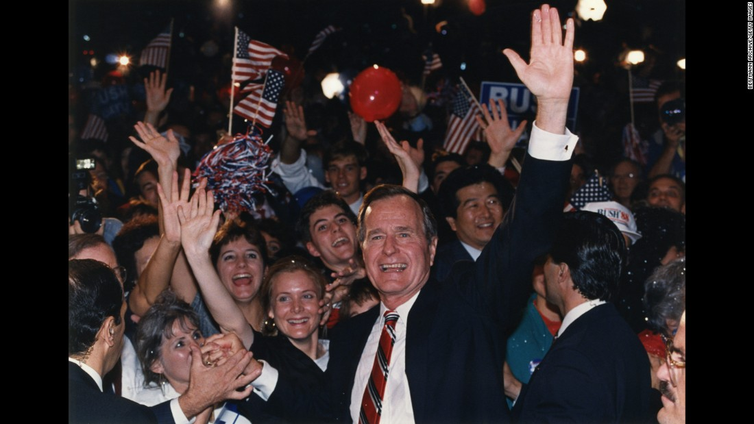 Bush waves to supporters in Houston in 1988 after learning he defeated Michael Dukakis in the presidential election.