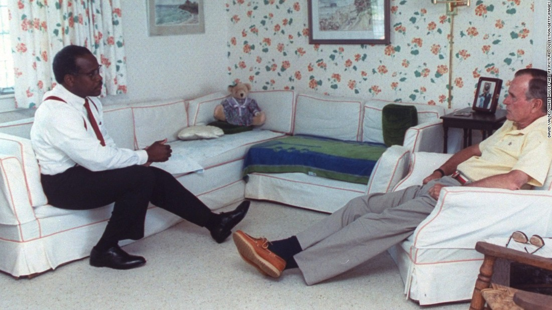 Bush meets with his US Supreme Court nominee Clarence Thomas in 1991 at Bush's vacation home in Kennebunkport, Maine.