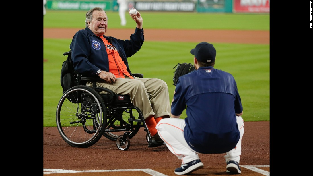 Bush throws out the first pitch to Collin McHugh of the Houston Astros before a game in April 2016 in Houston.