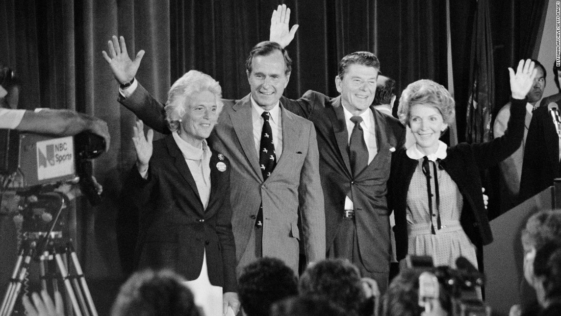 Bush and his wife stand before the press in 1980 with Republican presidential nominee Ronald Reagan. Bush would be formally nominated later that year as the vice presidential candidate.