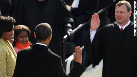 Barack Obama is sworn in as the 44th US president by Supreme Court Chief Justice John Roberts in front of the Capitol in Washington on January 20, 2009. At left is Michelle and Sasha Obama.