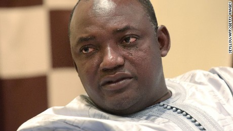 "Gambian president-elect Adama Barrow speaks during an interview in Banjul on December 12, 2016.  Adama Barrow said on December 12 that longtime leader Yahya Jammeh should step down immediately after Jammeh reversed his decision to concede defeat following a presidential election. ""I think he should step down now,"" Barrow told AFP. ""He has lost the election, we don't want to waste time, we want this country to start moving.""  / AFP / SEYLLOU        (Photo credit should read SEYLLOU/AFP/Getty Images)"