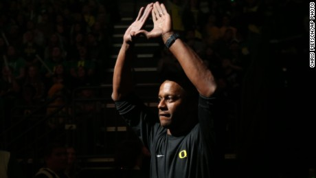 Oregon head football coach Willie Taggart flashed the sign of the O as he is intro ducted during halftime at the Oregon vs. Oregon State NCAA college basketball game Saturday, Jan. 14, 2017, in Eugene, Ore. (AP Photo/Chris Pietsch)