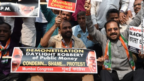 Indian Congress Party supporters shout slogans during a protest against demonetisation at the Reserve Bank of India in Mumbai on January 18, 2017. The shock November 8, 2016 announcement rendered 86 percent of India's currency void, giving customers until December 30 2016 to swap their old 500 rupee ($7.30) and 1,000-rupee bills for new ones. / AFP / INDRANIL MUKHERJEE        (Photo credit should read INDRANIL MUKHERJEE/AFP/Getty Images)