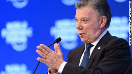Colombian President Juan Manuel Santos gestures while speaking after he received a prize from World Economic founder and executive chairman during a session at the Congress hall on the second day of the World Economic Forum, on January 18, 2017 in Davos. With the world's elite holding its breath until Donald Trump becomes the next US president, outgoing Vice-President Joe Biden addresses the World Economic Forum in Davos / AFP / FABRICE COFFRINI        (Photo credit should read FABRICE COFFRINI/AFP/Getty Images)