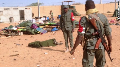 A soldier's body is covered with a blanket after a suicide bombing at a military camp in northern Mali on Wednesday.