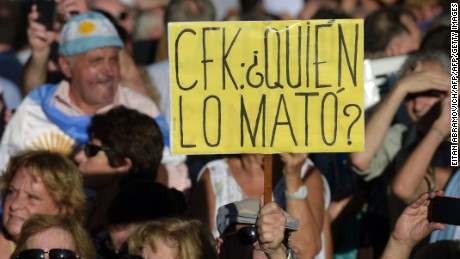 "A person holds a sign reading ""CFK, who killed him?"" during a vigil on the first anniversary of Argentinian prosecutor Alberto Nisman's mysterious death in Buenos Aires, on January 18, 2016. The prosecutor died in mysterious circumstances in January 18, 2015, after accusing Argentina's then president, Cristina Fernandez de Kirchner, of obstructing his investigation of a 1994 bombing at a Buenos Aires Jewish center. AFP PHOTO/EITAN ABRAMOVICH. / AFP / EITAN ABRAMOVICH        (Photo credit should read EITAN ABRAMOVICH/AFP/Getty Images)"