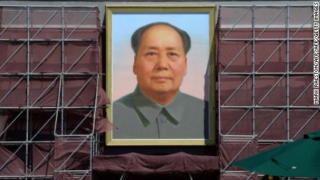 """A portrait of the late Chinese leader Mao Zedong on Tiananmen Gate is seen undergoing renovation in Beijing on August 29, 2013.  The European Union urged China on August 28 to release prominent activist Xu Zhiyong and others who it said were being held """"for peacefully expressing their views.""""     AFP PHOTO/Mark RALSTON        (Photo credit should read MARK RALSTON/AFP/Getty Images)"""