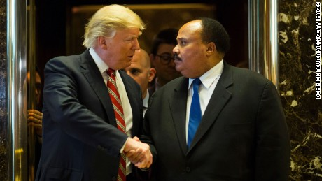 TOPSHOT - US President-elect Donald Trump shakes hands with Martin Luther King III after meeting at Trump Tower in New York City on January 16, 2017.  The eldest son of American civil rights icon Martin Luther King Jr. met with US President-elect on the national holiday observed in remembrance of his late father. / AFP / DOMINICK REUTER        (Photo credit should read DOMINICK REUTER/AFP/Getty Images)