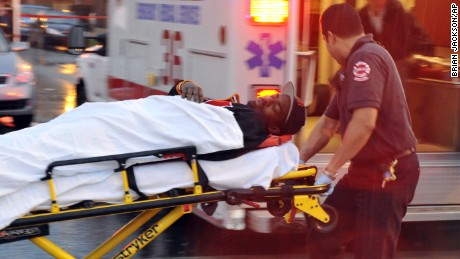 A man is taken to a waiting ambulance from inside of the Best Buy Meats & Groceries store after being shot at 71st & Paxton Wednesday May 6, 2009. Authorities say four people have been shot, one fatally by Chicago Police, in gunfire on the city's South Side. (AP Photo/Brian Jackson - Chicago Sun-Times)