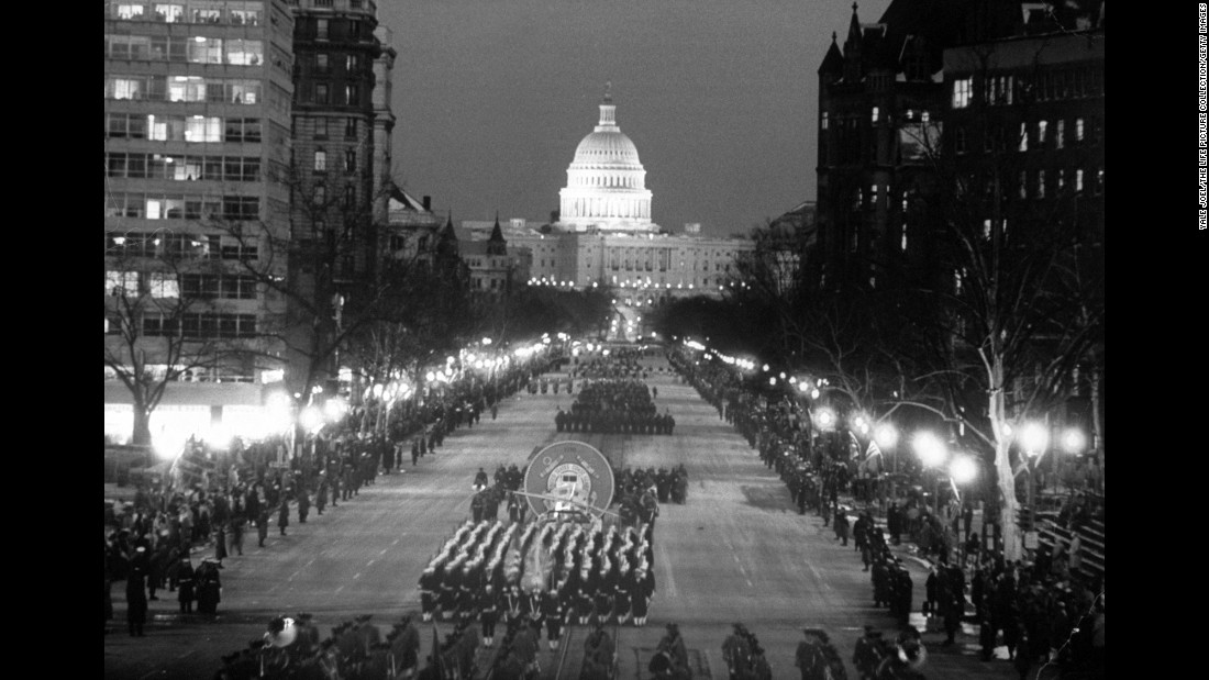 "A view of the inaugural parade. The tradition, <a href=""http://www.inaugural.senate.gov/days-events/inaugural-parade"" target=""_blank"">according to the Joint Congressional Committee on Inaugural Ceremonies</a>, dates back to George Washington's inauguration in 1789. Early parades mostly consisted of military escorts, but by 1841, when William Henry Harrison was inaugurated, they began to feature floats, citizens groups and bands."