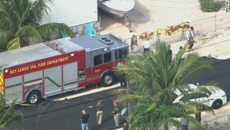 A fire engine is parked near the manhole leading to an underground pipeline in Key Largo, Florida, where three construction workers died on Monday.
