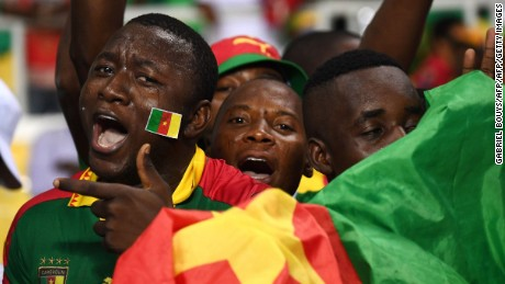 Cameroon supporters cheer for their team ahead of the 2017 Africa Cup of Nations group A football match between Cameroon and Guinea-Bissau at the Stade de l'Amitie Sino-Gabonaise in Libreville on January 18, 2017. / AFP / GABRIEL BOUYS        (Photo credit should read GABRIEL BOUYS/AFP/Getty Images)