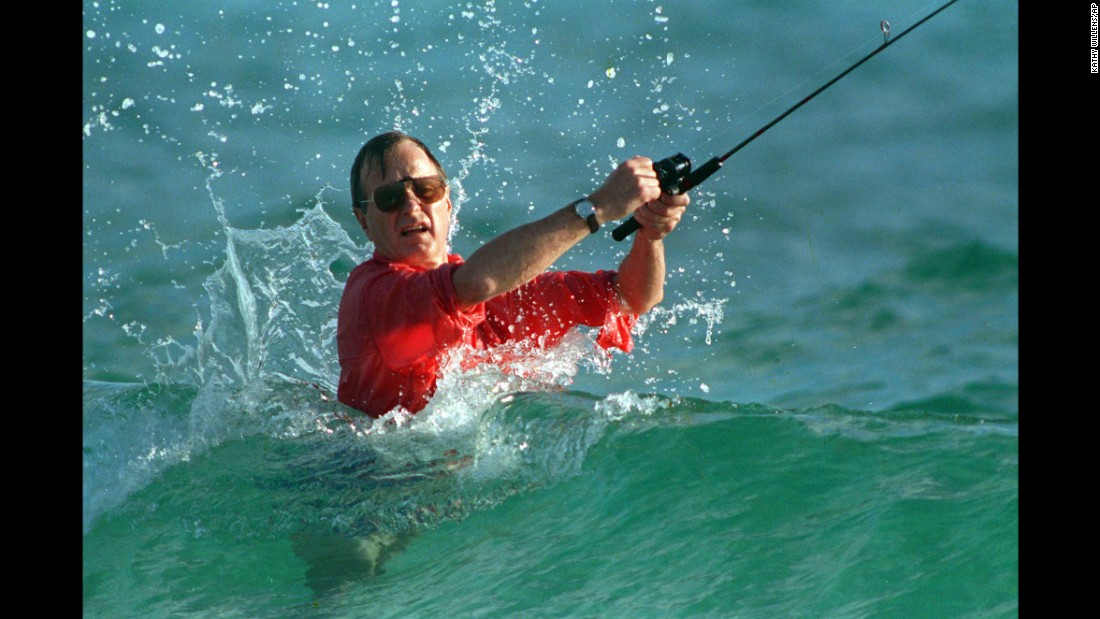 Bush casts a line while surf fishing in Gulf Stream, Florida, in November 1988 shortly after winning the election.