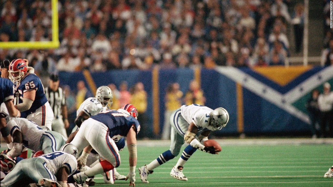 James Washington of the Dallas Cowboys recovers the football after it was fumbled by the Buffalo Bills' Thurman Thomas during the third quarter of Super Bowl XXVIII in the Georgia Dome on January 30, 1994. The Cowboys went on to defeat the Bills, 30-13.