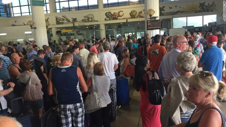 Tourists gather at the airport in Banjul as tour operators send in extra flights to evacuate them Wednesday January 18.
