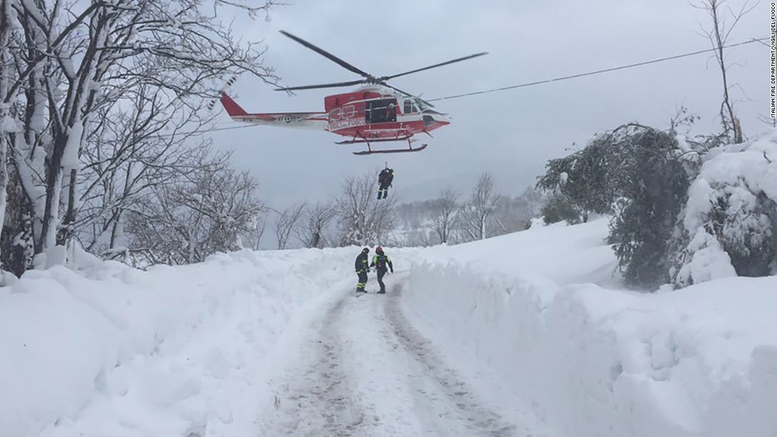 Rescuers are dropped by helicopter near the site of the avalanche. Weather conditions in the region made it difficult to access the area by road.