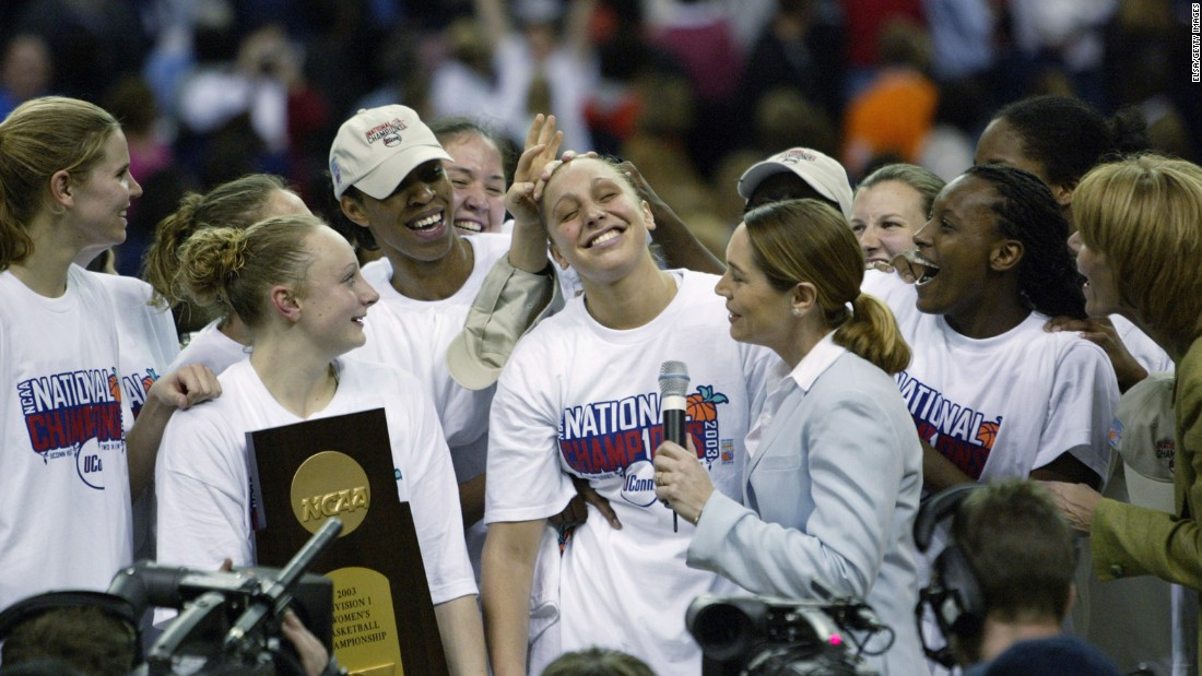 Connecticut's Diana Taurasi leads her teammates in celebration after winning the NCAA women's basketball championship game on April 8, 2003 at the Georgia Dome. UConn defeated Tennessee, 73-68.