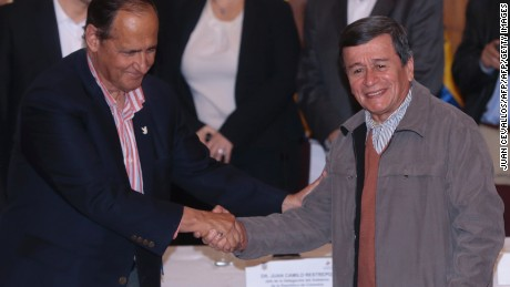 Colombian government representative Juan Camilo Restrepo (L) and  Colombia's ELN guerrilla representative Pablo Beltran (R) shake hands during a press conference in the framework of the peace talks between the Colombian government and the ELN, in Quito, on January 18, 2017.  Colombia announced a deal Wednesday to launch peace talks with its last active rebel group, the ELN. / AFP / JUAN CEVALLOS        (Photo credit should read JUAN CEVALLOS/AFP/Getty Images)