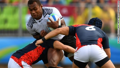 TOPSHOT - Fiji's Leone Nakarawa is tackled in the mens rugby sevens semi-final match between Fiji and Japan during the Rio 2016 Olympic Games at Deodoro Stadium in Rio de Janeiro on August 11, 2016. / AFP / Pascal GUYOT        (Photo credit should read PASCAL GUYOT/AFP/Getty Images)