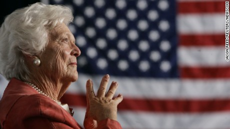 Former U.S. first lady Barbara Bush listens to her son, President George W. Bush, as he speaks at an event on social security reform in Orlando, Florida, in this March 18, 2005, file photo. Former first lady Barbara Bush was discharged from the Houston Methodist Hospital on January 4, 2014 following six days of treatment for pneumonia. REUTERS/Jason Reed/Files (UNITED STATES - Tags: POLITICS) (Newscom TagID: rtrlsix214244.jpg) [Photo via Newscom]