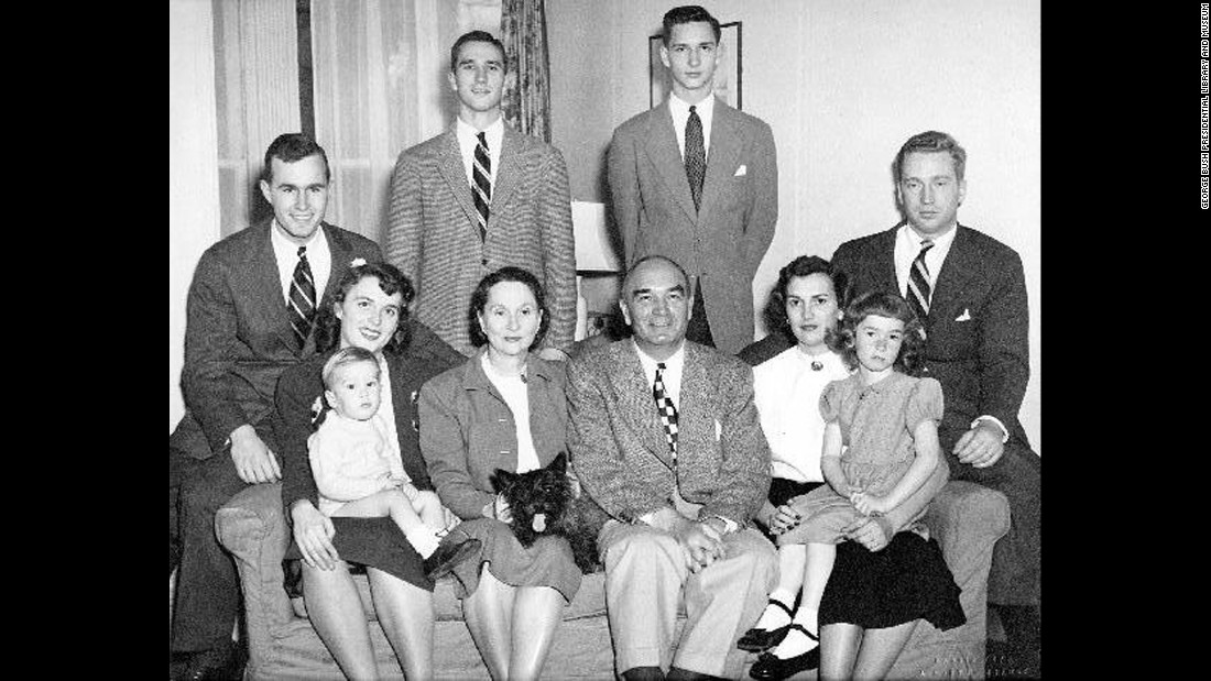 A family portrait in New Haven, Connecticut, around 1948. Pictured are Bush's husband, brothers, parents, and sister, along with her sister's family.