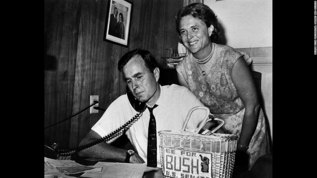 Bush with her husband as he campaigns for Senate in 1964. On the desk is a needlepoint bag made by Bush.