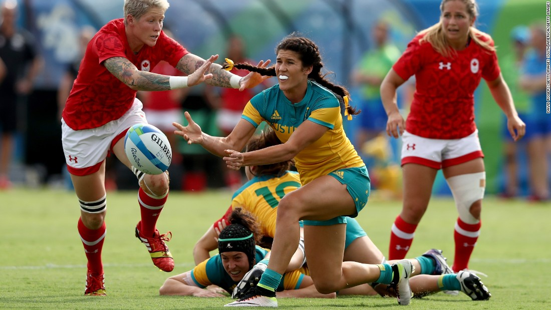 """In sevens we tend to look at staying above the ball, protecting the ball whilst engaging in that ruck, that breakdown, so when that ball is presented, we can play away."" Here, Australia's Charlotte Caslick starts another cycle of play after her grounded teammates retain possession."