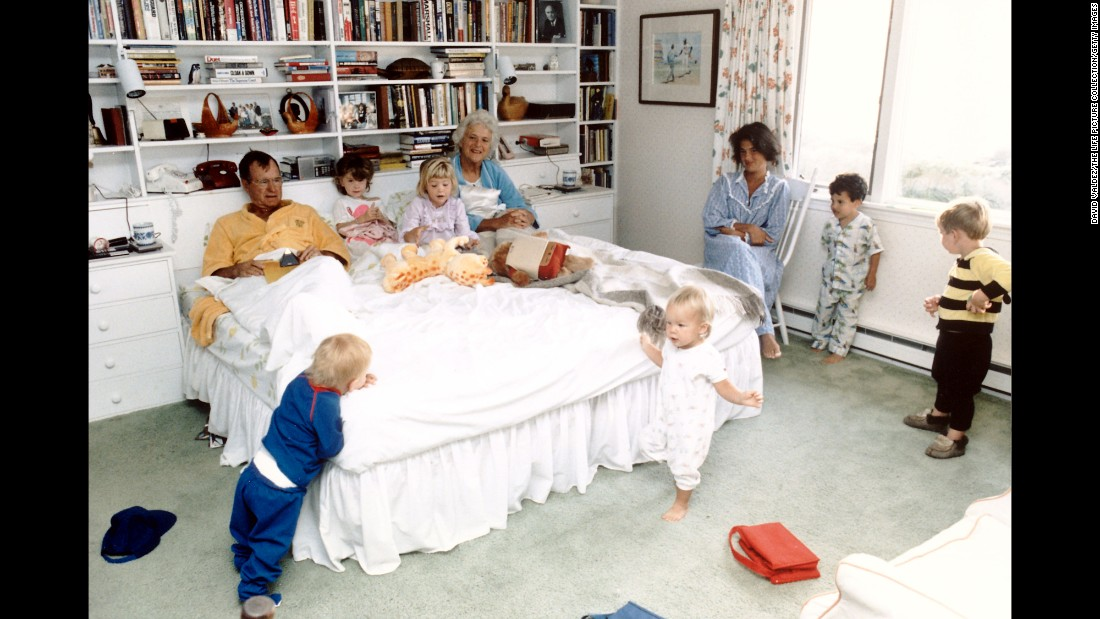 Bush with her husband, then President, in a bedroom with their grandchildren.