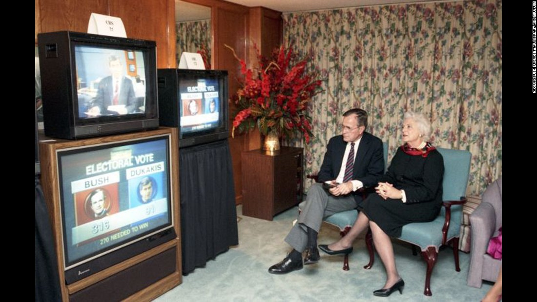 Bush sits with her husband as they watch the presidential election results in Houston, Texas, on November 8, 1988. Her husband was elected the 41st President of the United States that day, with 53.1% of the popular vote and 426 electoral votes. He defeated Democratic nominee Michael Dukakis.