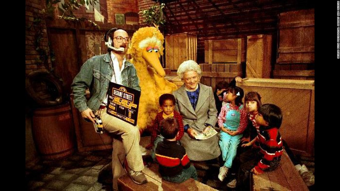 "Bush reads to children and Big Bird on the set of ""Sesame Street"" in New York on October 19, 1989."