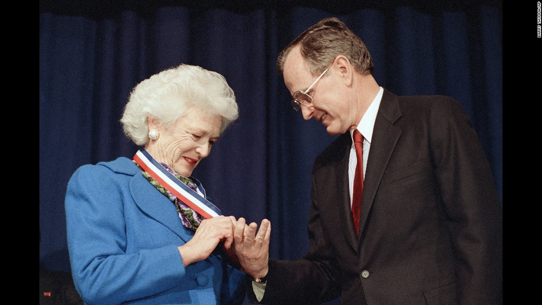 The President admires the Harry S. Truman Award for Distinguished Service that his wife received in Washington on March 30, 1989. The award was presented by the Association of Community and Junior Colleges.