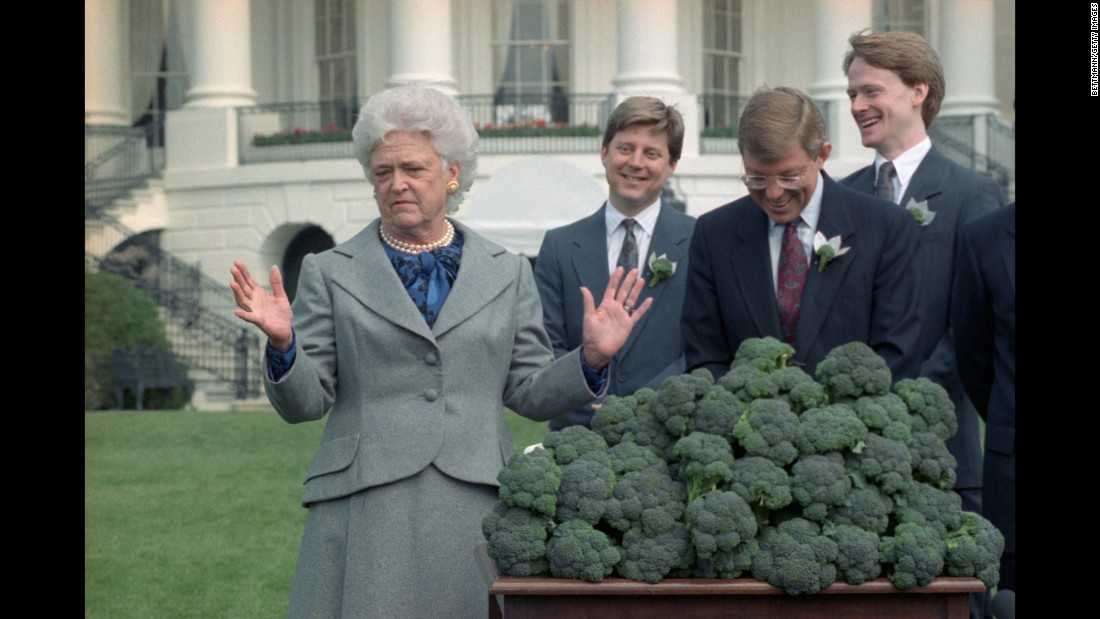 The first lady accepts three cases of broccoli from a California fruit and vegetable grower's association during a ceremony at the White House in Washington. The group shipped a total of 10 tons of broccoli after President Bush proclaimed his dislike for the vegetable. The remaining broccoli went to area food banks.