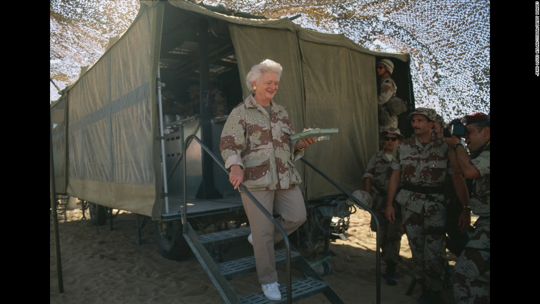 Barbara Bush celebrates Thanksgiving with US Marines in Saudi Arabia during the Gulf War.