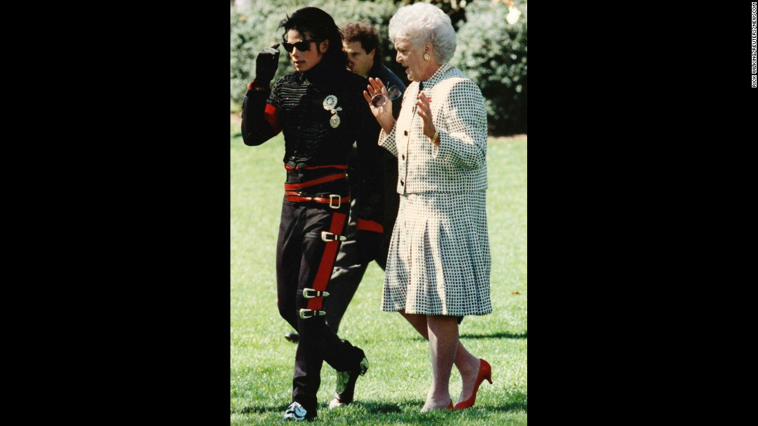 "Michael Jackson, the ""King of Pop,"" walks with the first lady near the Rose Garden at the White House in Washington."