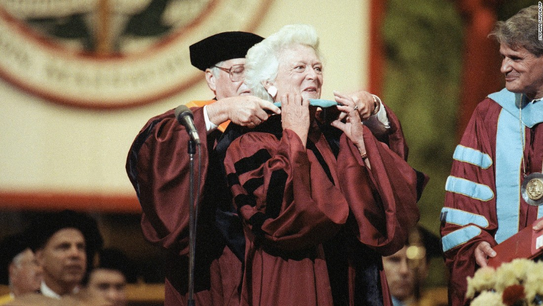 Barbara Bush has a doctoral hood placed over her shoulders during Northeastern University's spring commencement in Boston on June 15, 1991. Bush was the commencement speaker and recipient of an honorary doctorate for public service.