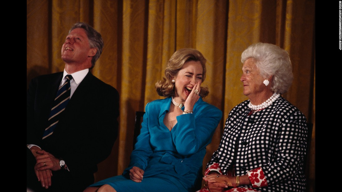 Barbara Bush sits beside Bill Clinton and his wife, Hillary. Clinton was the 42nd President of the United States and followed George H.W. Bush in the White House.