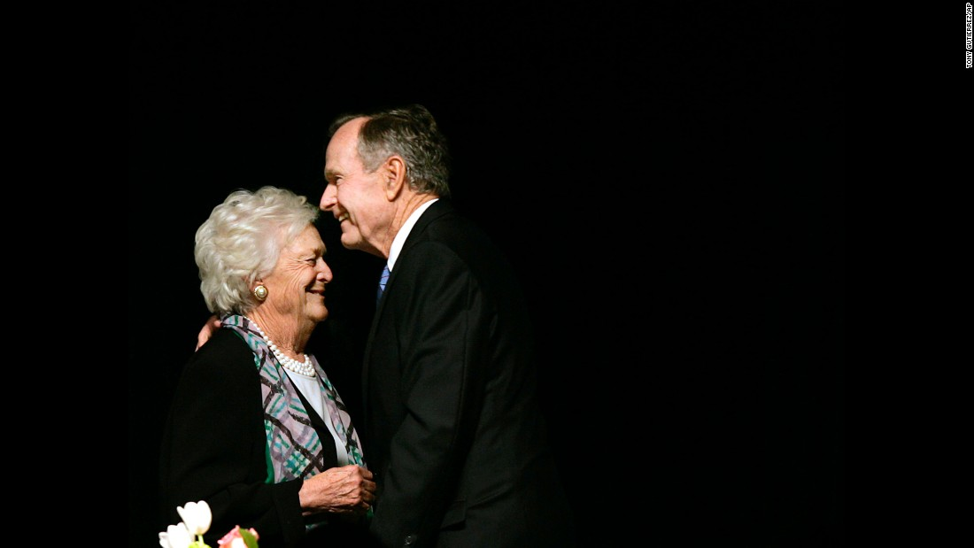 The former President embraces his wife after she introduced him at the Genesis Women's Shelter Mother's Day Luncheon in Dallas, Texas, on May 3, 2006. The Bushes were the featured speakers at the event.