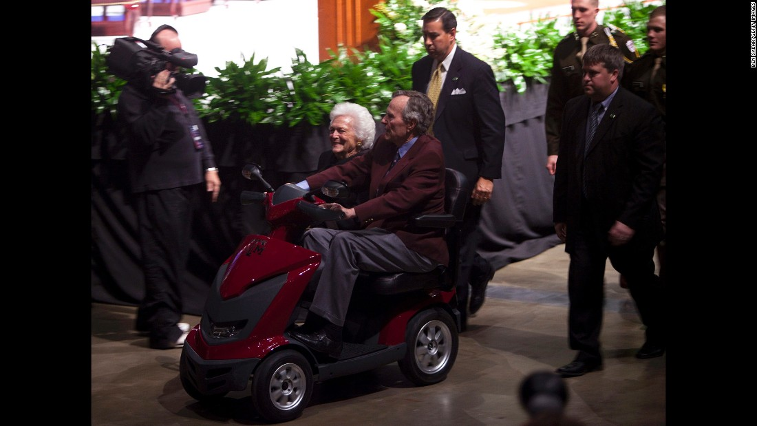 The former President and first lady leave after a panel discussion at an event commemorating the Persian Gulf War in College Station, Texas, on January 20, 2011. The Gulf War was waged against Iraq from August 1990 to February 1991 during President Georgia H.W. Bush's administration.