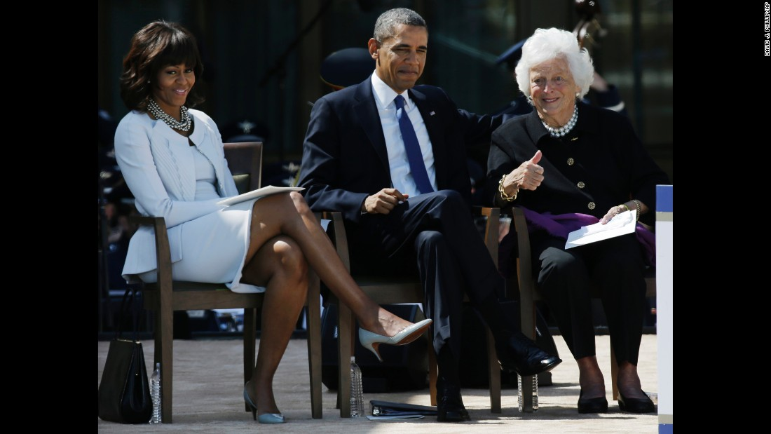 The former first lady gives the thumbs-up to guests during a dedication of the George W. Bush Presidential Center in Dallas, Texas, on April 25, 2013. She is seated next to then-President Barack Obama and then-first lady Michelle Obama.